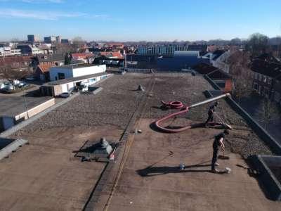 Dakgrind verwijderen Oosterhout