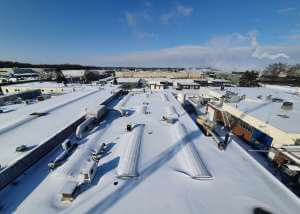 Sneeuw wegzuigen van daken - Methorst Zuigtechniek